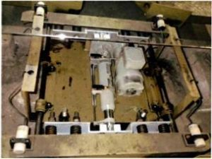 水平循環式駐車装置パワーシリンダー交換事例(取付部加工)