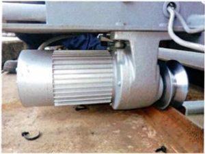 横行昇降式駐車装置横行モーター交換事例(横行ローラーを自社にて設計)